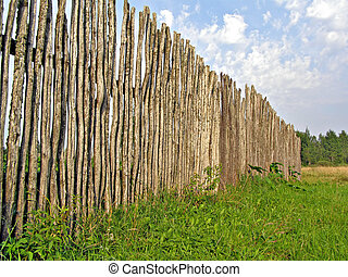 old fence on green field
