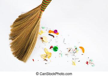 broom sweeping various debris - a new broom sweeping various...