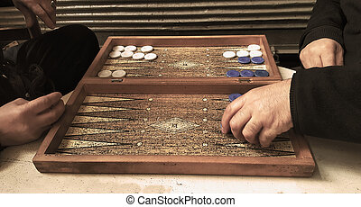 Two men playing backgammon