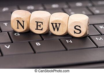 News - Keyboard and wooden cubes with the word News