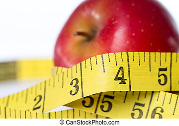 healthy living - apple and tape measure