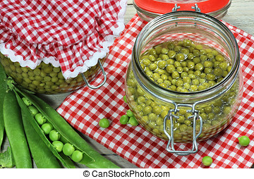 peas - home canned peas on wooden table