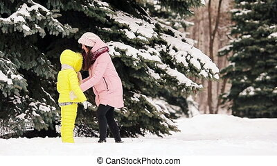 Happy mother and kid enjoy winter snowy day - Happy family...