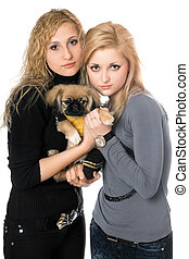 two pretty young women with pekingese