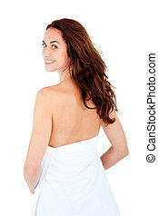 Radiant caucasian woman with a towel on her body smiling at...