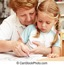 Grandma and grand-daughter painting