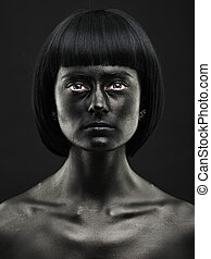 Natural portrait of a dark-skinned beautiful girl. Black...