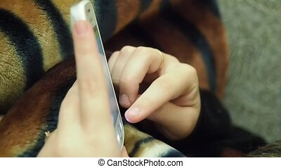 Cropped video of female hands scrolling on smart phone. -...