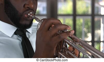 Black trumpet player. Musician with closed eyes.