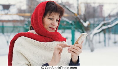 Middle aged woman speaking by the phone - Eldery woman in a...
