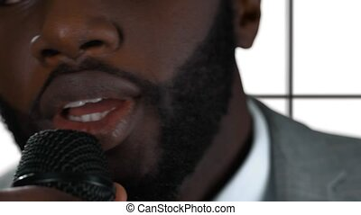 Afro-american man singing isolated. Closeup of guy holding...