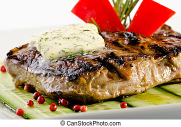 Ribeye steak on a cucumber bed