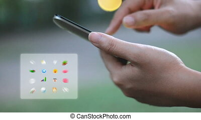 Hands of woman using mobile smartphone with application icon...