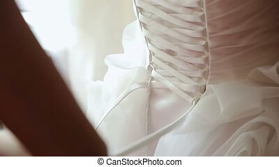 Wearing wedding dress for bride