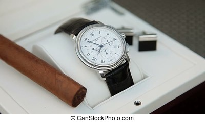 Wrist watch timelapse with cigar and cufflinks