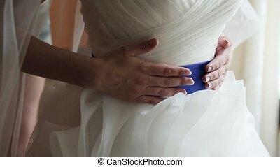 Bride wearing blue belt on wedding dress