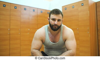 Handsome sporty man smile and posing into camera in fitness...