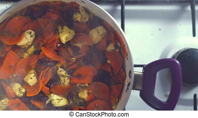 A colorful variety of vegetables, boiling in a pan on the...