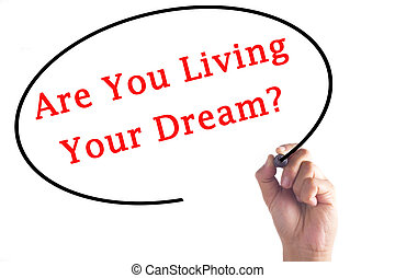 Hand writing Are You Living Your Dream? on transparent board
