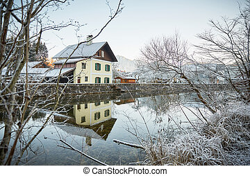 House at the river with frost and ice