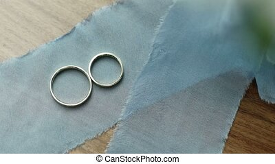Wedding rings on blue ribbon shot