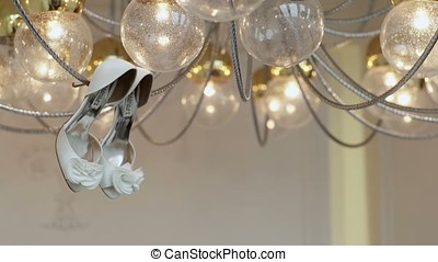 Bridal shoes on lamp shot
