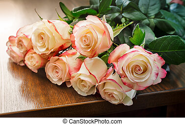 Bouquet of roses on the table.