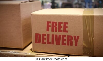 Free delivery cartons at logistics center - Goods packed in...