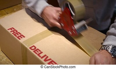 FREE DELIVERY of online items - Production worker sealing...
