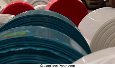 Rolls of plastic sheeting in various colors