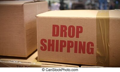Drop shipping goods packed in cartons at logistics center -...