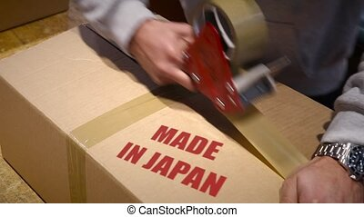Shipment of goods made in Japan - Production worker sealing...