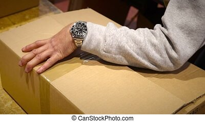 Worker prepare package box for shipment - Production worker...
