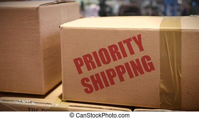 Priority Shipping cartons at logistics center - Goods packed...