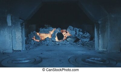 Wood burning in the old traditional Russian stove. Fire...