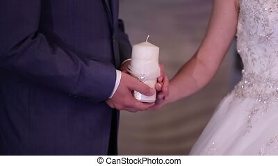Bride and groom with candle - Bride and groom staying with...