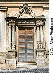 Ornated door seen in Caltagirone, Sicily - An ornated old...