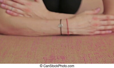 Young sporty woman practicing yoga in fitness studio - Young...