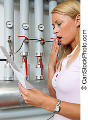 Women with billing of heating costs for heating - A young...