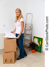 Woman with a plan in the new apartment move.