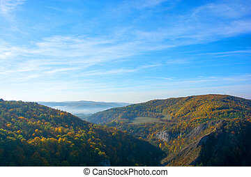 Colorful autumn mountain valley in the mist