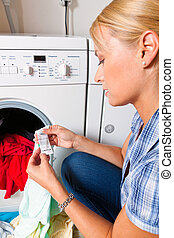Housewife washing and laundry Washing day - A young...