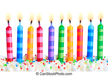 Birthday candles - Ten birthday cake candles against a white...