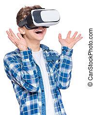 Teen boy in VR glasses - Amazed teen boy wearing virtual...