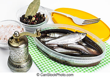 Salted sprats in plastic jar