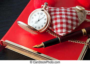 Pen on notebook - Beautiful pen and pocket watch on the...