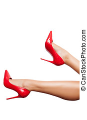 Red high heels shoes in perfect legs over white background