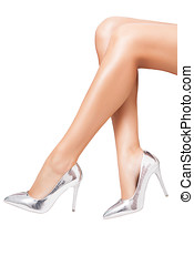 Perfect luxury shoes on elegant legs over white background....