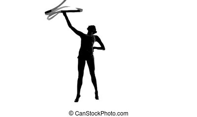 Girl gymnast with ribbon in hand revolve around him. Silhouette. White background. Slow motion