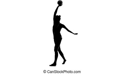 Gymnast to be turned with the ball in his hands. White background. Silhouette. Slow motion